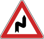 Verkehrszeichen StVO, Doppelkurve (zun&auml;chst rechts) Nr. 105-20 (Seitenl&auml;nge/Folie/Form:  <b>630mm</b>/RA1/Flachform 2mm (Art.Nr.: 105-20-111))