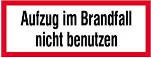 Hinweisschild Aufzug im Brandfall nicht benutzen (Maße (BxH)/Material: 148 x 52 mm / Folie, selbstklebend<br> <b>langnachleuchtend</b> (Art.Nr.: 38.2883))