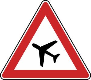 Verkehrszeichen 101-10 StVO, Flugbetrieb, Aufstellung rechts (Seitenlänge/Folie/Form:  <b>900mm</b>/RA1/Flachform 2mm (Art.Nr.: 101-10-211))