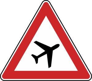 Verkehrszeichen 101-20 StVO, Flugbetrieb, Aufstellung links (Seitenlänge/Folie/Form:  <b>900mm</b>/RA1/Flachform 2mm (Art.Nr.: 101-20-211))