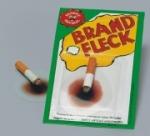 Brandfleck, 1x glimmende Zigarette und ein Brandfleck als Scherzartikel, Party-Gag,